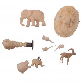 A Small Collection Of Ivory Items, To Include