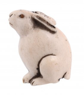 A Bone Netsuke Of A Hare , The Animal With Its Ears