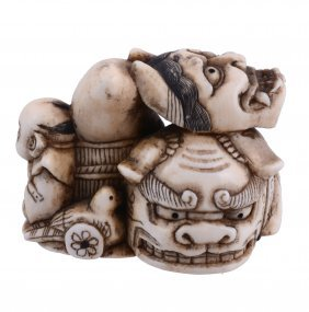 An Ivory Netsuke Comprising A Still-life Group Of A