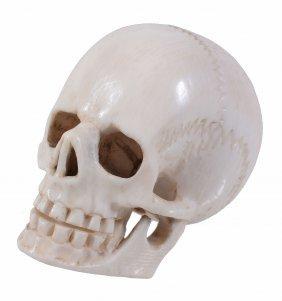 An Ivory Netsuke Modelled As A Well Detailed Human