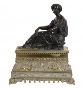 A French Patinated Bronze And Gilt Bronze Mounted Model