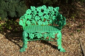 A Scottish Victorian Painted Cast Iron Garden Seat,