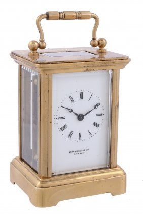 A French Lacquered Brass Miniature Carriage Timepiece