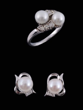 A Cultured Pearl And Diamond Crossover Ring
