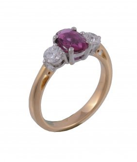 An 18 Carat Gold Ruby And Diamond Ring, The Central