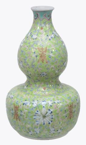 A Chinese Double Gourd Green-ground Vase, Painted With