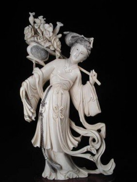 CHINESE CARVED IVORY FIGURINE: WOMAN WITH FLOWERS