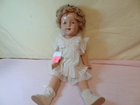 23'' COMPOSITION SHIRLEY TEMPLE DOLL, JOINTED SHOULD