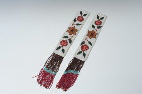 A PAIR OF YAKIMA FLORAL BEADED PANEL STRIPS