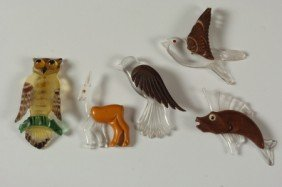FIVE CATLIN AND LUCITE ART DECO CARVED PLASTIC PINS
