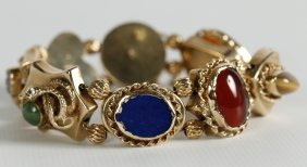 A Bracelet Of Eight Victorian 14k Gold Watch Slides