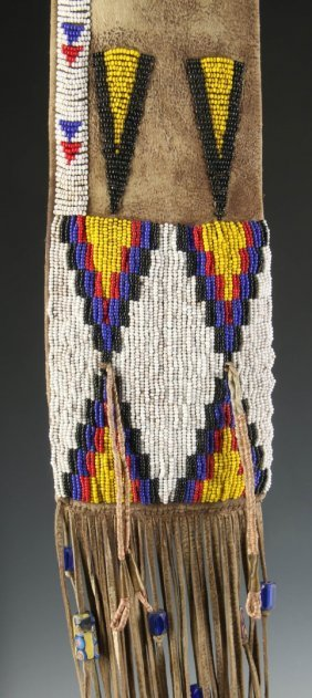 A 20th C. Plains Indian Beaded And Fringed Hide Pipe