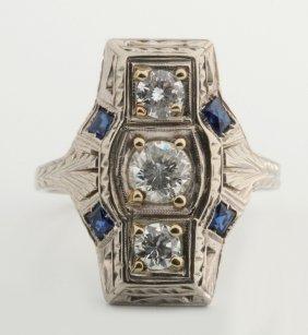 A Ladies Platinum 3/4 Ct Tw Diamond & Sapphire Ring