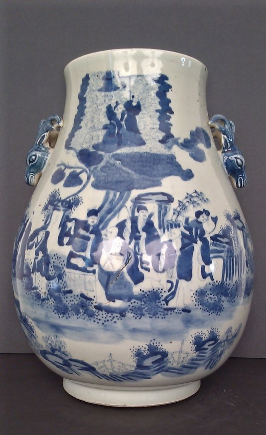 A Blue And White Porcelain Vase With Deer Head Handles