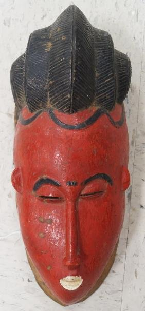 GURO, IVORY COAST, CARVED AND PAINTED CEREMONIAL MASK.