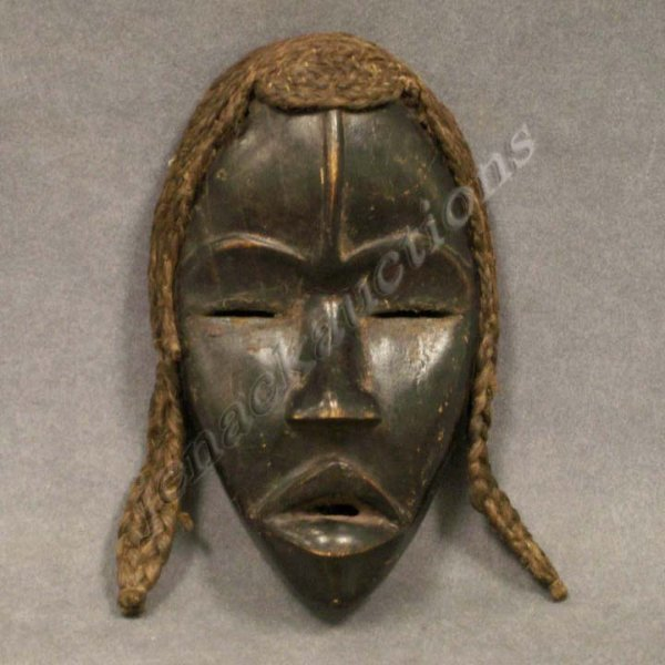 Dan carved mask with braided hair lot