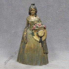 VINTAGE CAST IRON PAINTED DOORSTOP, COLONIAL LADY