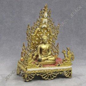 THAI GILT SHRINE WITH GILT BRONZE SEATED BUDDHA