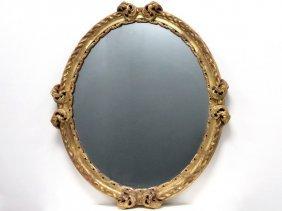 Friedman Bros. Carved And Gilt Framed Oval Mirror.