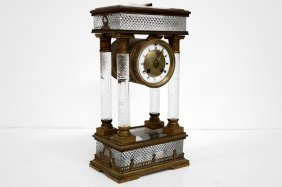 FRENCH EMPIRE CUT CRYSTAL AND BRASS PORTICO CLOCK, 19TH