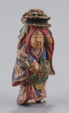 A Painted Wood Netsuke Of The Dancer Of Shakkyo.