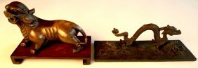 An C18th/C19th Chinese Bronze Of A Lion-dog On Scro