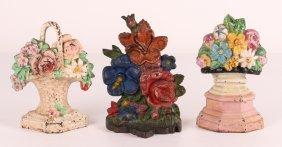 Three Antique Cast Iron Flower Bouquet Doorstops