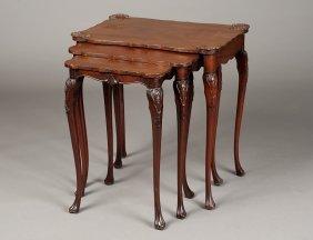 NEST OF THREE GEORGE II STYLE MAHOGANY TABLES