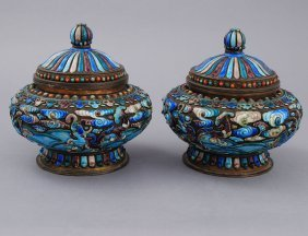 PAIR OF ENAMEL ON METAL URNS AND COVERS