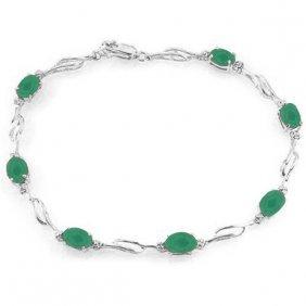 14k. White Gold Tennis Bracelet With Emeralds & Diamond