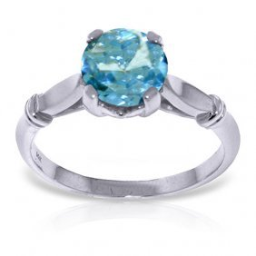 Platinum Plated Sterling Silver Solitaire Ring With Blu