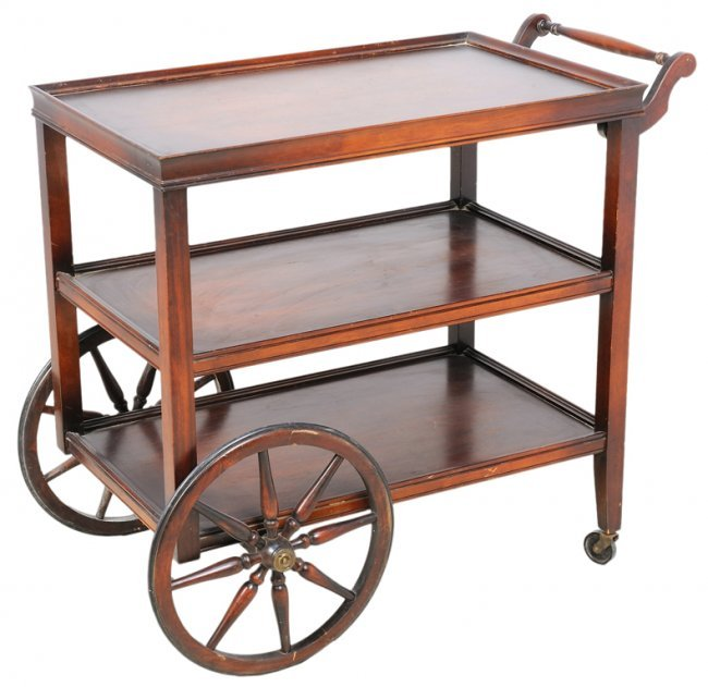 A Vintage Rolling Serving Cart With Wagon Wheels Lot 124