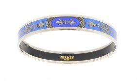 AN HERM�S BLUE ENAMEL AND PALLADIUM BANGLE BRACELET