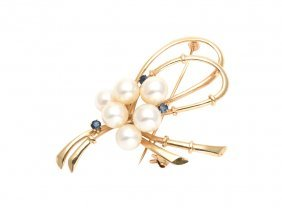A Pearl And Sapphire Brooch