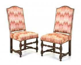 A Pair Of Louis Xiii Style Carved Mahogany Chairs