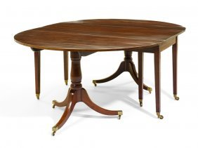 A George Iii Two Pillar Mahogany Extension Dining Table