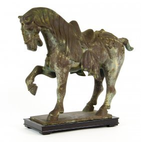 A Cast Metal Statue Of A Horse In The Chinese Style
