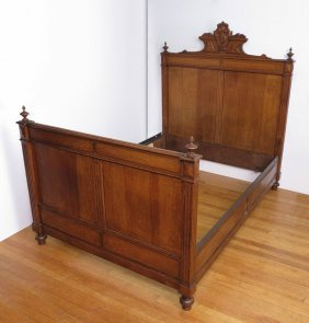 LATE VICTORIAN CARVED OAK BED