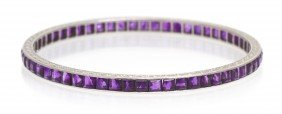 An Edwardian Platinum And Amethyst Bangle Bracelet,