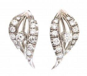 A Pair Of 18 Karat White Gold And Diamond Earrings