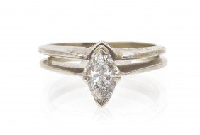A 14 Karat White Gold And Diamond Solitaire Ring,