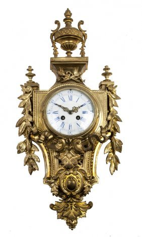 A Louis XVI Style Gilt Bronze Cartel Clock, Height