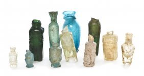 A Collection Of Eleven Glass Bottles, Height Of T