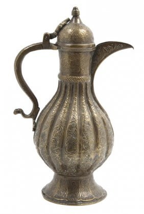 An Indian Gilt Metal Ewer, Height 11 Inches.