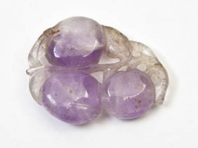A Chinese Amethyst Toggle, Height 2 3/8 Inches.