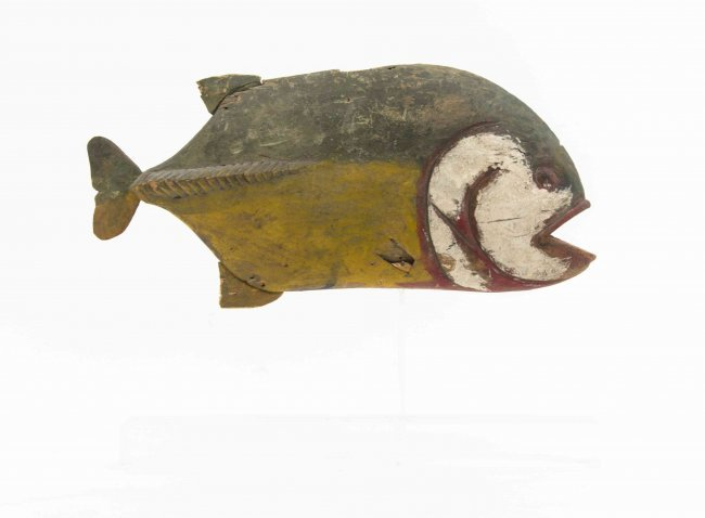 A folk art carved wood and polychrome decorated fish
