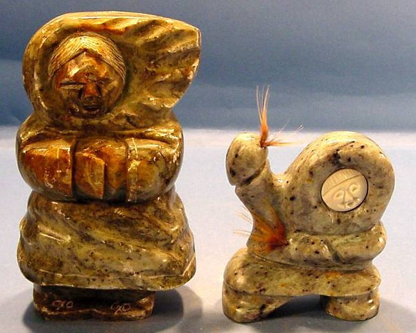 Two eskimo stone carvings green carving