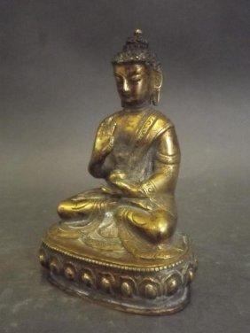 A Sino-tibetan Gilt Bronze Figure Of Buddha Seated Upon