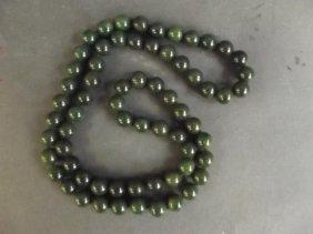 "A String Of Apple Jade Beads, 35"" Long"