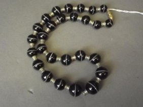 An Agate Bead Necklace With Silver Plated Spacers